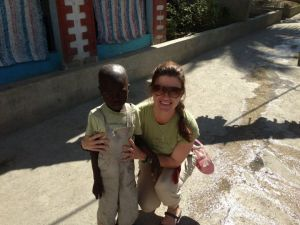 Olivia and the orphan she and her husband sponsor Youcanlove Delva in Haiti December 2012